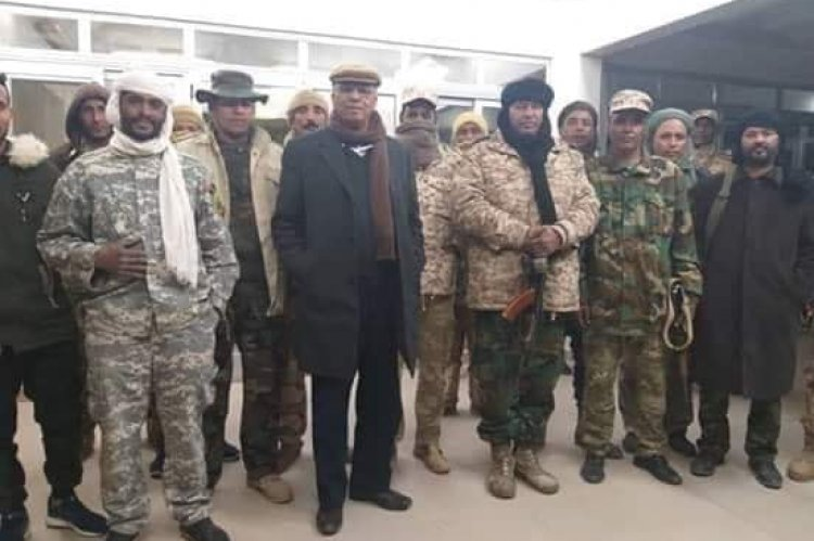 Ali Kanah escorted with his guards inside Sharara oilfield