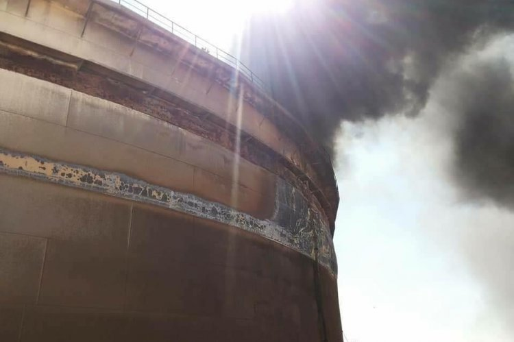 Storage tank No. 12 of the Harouge Oil Company on fire