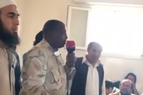 Wanis Bu Khamada addressing a tribal group to give excuses for the shocking videos of crimes