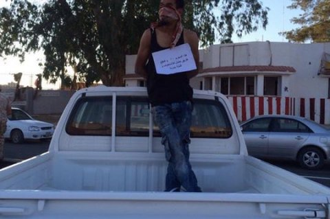 Security forces in Tripoli's Qasir Ben Ghashir district nabbed a notorious criminal and put him on public display. The criminal was caught red-handed committing armed-robbery. Monday, June 29, 2015.