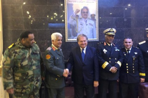 Federpesca president Luigi Giannini shakes hands with chief of Military Investment Mohammed Fakhari