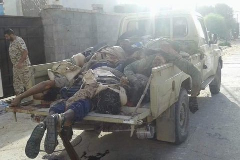 Bodies of ISIS militants piled onto a pickup truck following the failed attack
