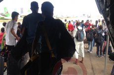 The passengers leaving the plane after emergency return