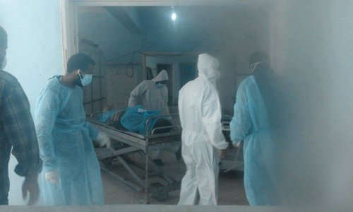 Sabha Medical Center begins burying corpses accumulated inside its morgue